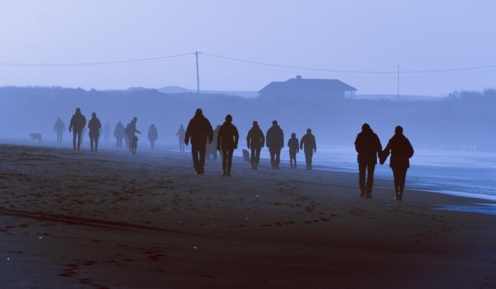 Silhuetter på stranden